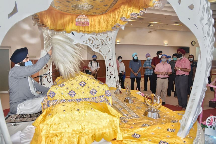 Minister for Culture, Community and Youth Edwin Tong (second from right) with Mr Baljit Singh (right), president of the board of Central Sikh Temple, during a visit to the temple on Sept 26, 2020.