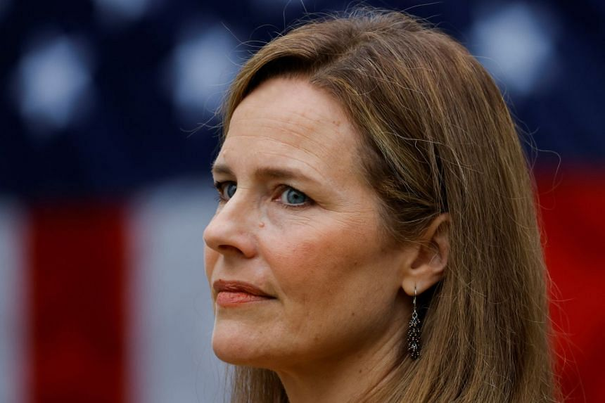 Amy Coney Barrett looks on as US President Donald Trump announces her as his Supreme Court nominee.