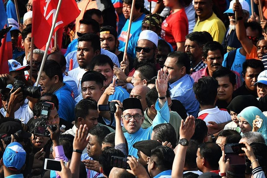 Mr Anwar (centre) greeting supporters on Nomination Day for the Port Dickson by-election. His Oct 13, 2018 victory marked his official return to politics.