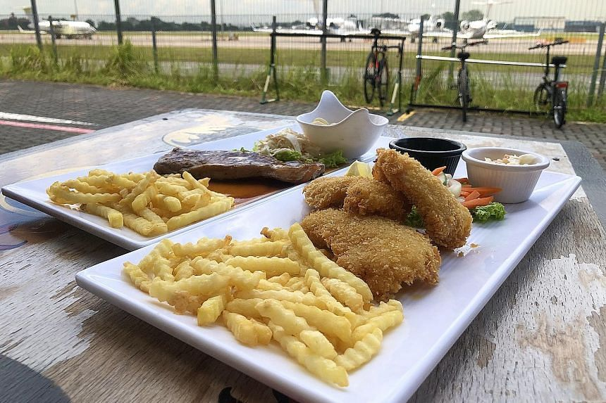 Tuck into fish and chips at Soek Seng 1954 Bicycle Cafe, which features bike art installations.