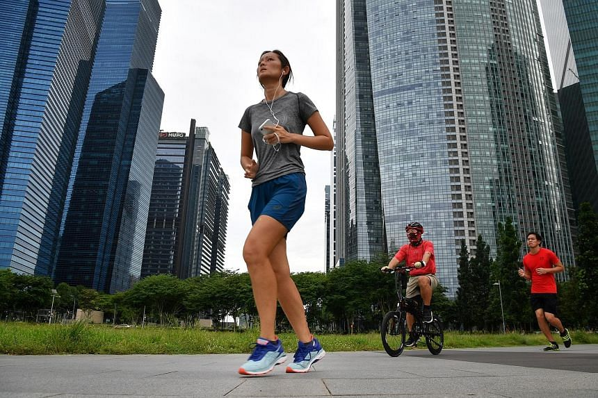 Listening to music while working out can enhance performance, as songs are motivational and provide tempo. Podcasts, while slower, can also aid runners and offer an alternative to music. ST PHOTO: CHONG JUN LIANG
