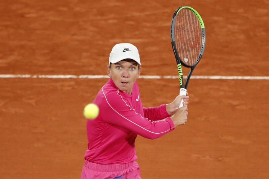 Romania's Simona Halep in action during her first round match against Spain's Sara Sorribes Tormo.