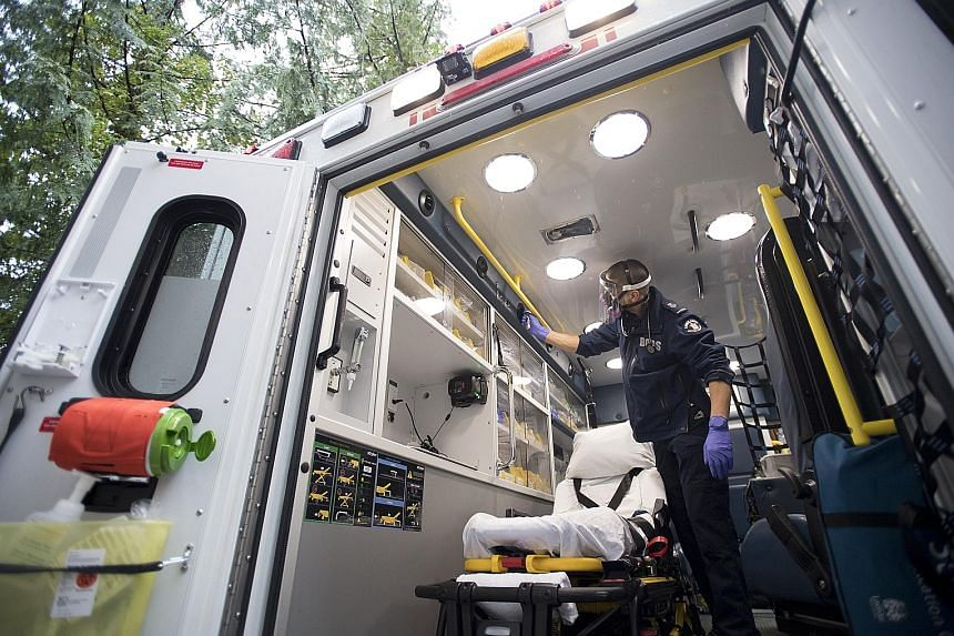 Concern over the suspected Covid-19 patient's oxygen levels led emergency doctor Mathieu Surprenant to make the call to intubate the patient, assessing that it was his best chance of survival. Paramedic Jeff Booton cleaning his ambulance in Lions Bay
