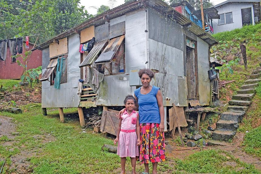 Right and far right: Ms Temalesi Tauga with her six-year-old daughter Keran Alice at their Kalekana home in the Fijian capital city of Suva. Ms Tauga now has an almost-new stove, a full cylinder of gas and ingredients to start a baking business, afte