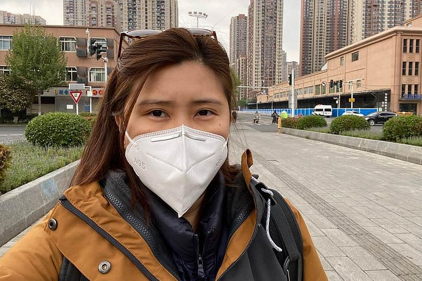 Above: Jinyintan Hospital in the Chinese city of Wuhan was one of the first to start treating Covid-19 patients. Right: ST's China correspondent Elizabeth Law in Wuhan. In the background is Huanan Seafood Wholesale Market, where the coronavirus was b