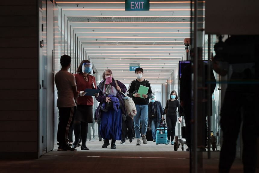 Passengers arriving on a Singapore Airlines flight to Changi Airport Terminal 3, on June 23, 2020.
