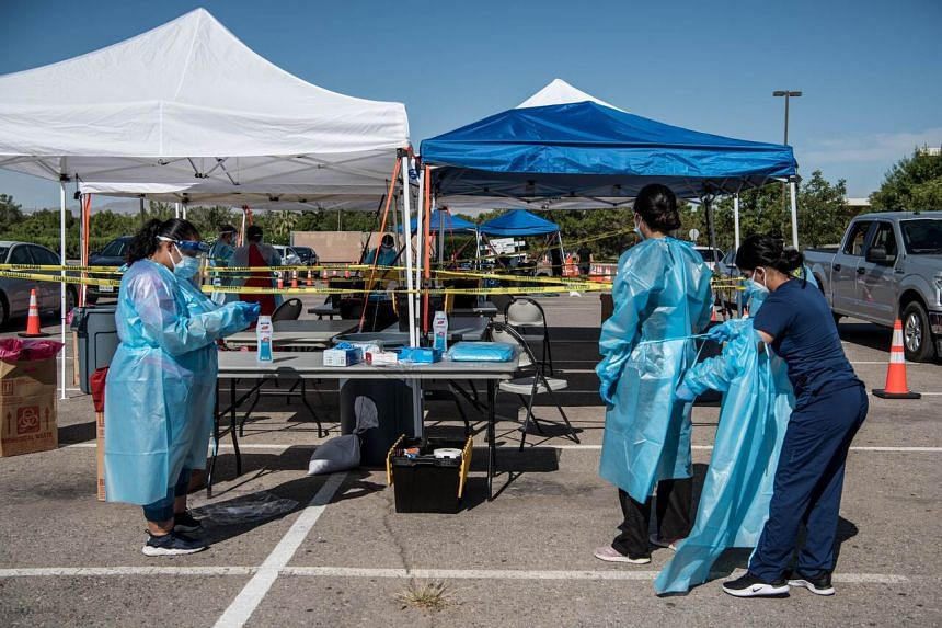 Nurses prepare themselves for coronavirus testing at El Paso Community College Valle Verde campus, on July 21, 2020.