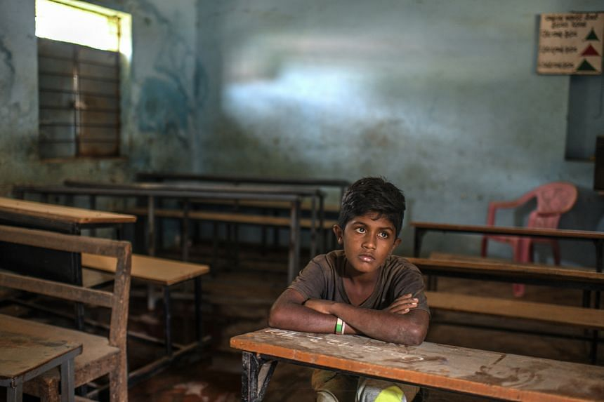 Rahul sits in his now closed classroom in Tumakuru, India on Sept 11, 2020.