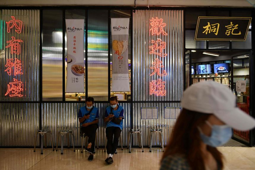 Food delivery riders outside a restaurant in Beijing. The Chinese capital has issued coupons for food delivery orders, with more than 70,000 merchants participating. A worker spraying disinfectant at a temple in Denpasar, Bali. The Indonesian governm