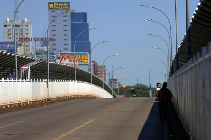 The closure of the International Friendship Bridge connecting Foz do Iguacu in Brazil and Ciudad del Este in Paraguay has disrupted life for those living on the Triple Border, which includes Argentina's Puerto Iguazu.