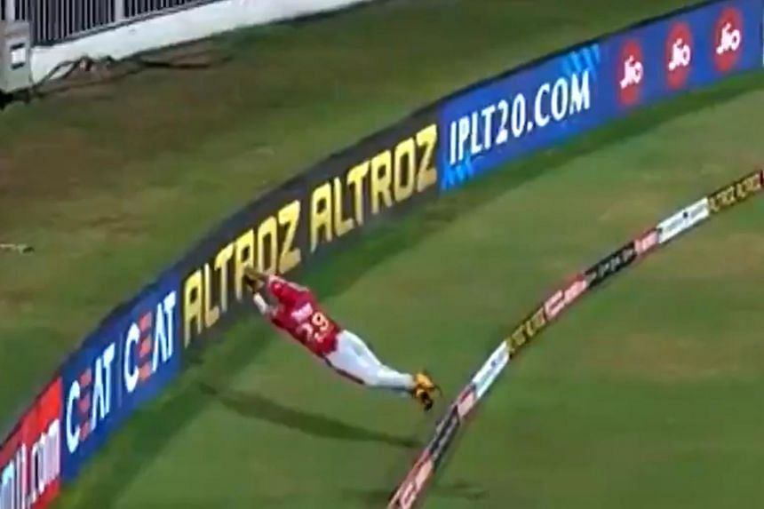 Nicholas Pooran dived cat-like to grab the ball before twisting in mid-air and backhanding it over the rope before he hit the ground.