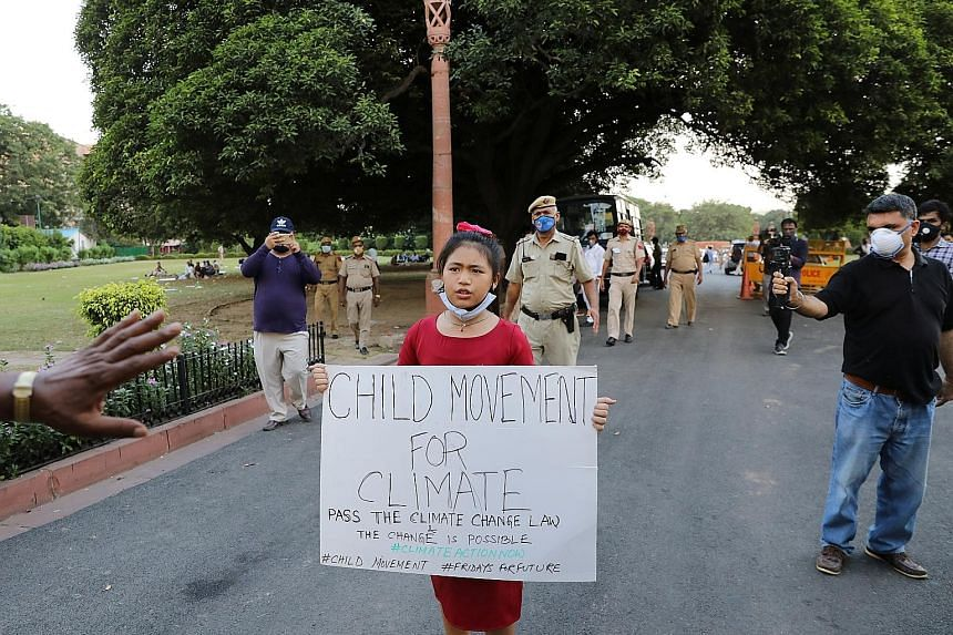 Eight-year-old Licypriya Kangujam protesting outside India's Parliament in New Delhi last Wednesday. She is leading a youth movement calling for Prime Minister Narendra Modi and Indian lawmakers to pass a law aimed at capping carbon emissions in the