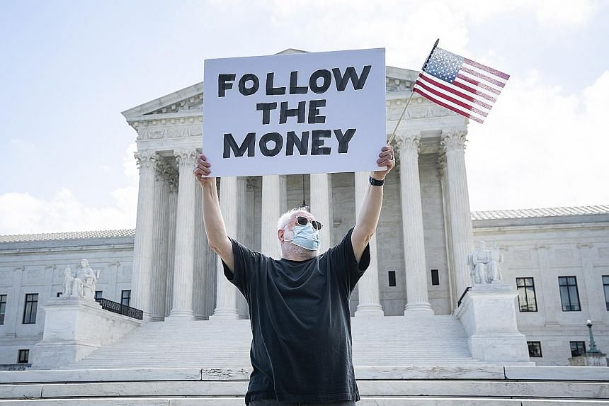A protester outside the Supreme Court in July as it ruled on two cases seeking to acquire President Donald Trump's financial records, including his tax returns. President Donald Trump speaking during a news conference at the White House on Sunday. He