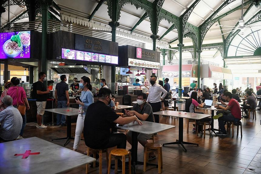 8.22am: The area outside Raffles Place MRT station seemed empty, even as the workday was about to begin. 12.26pm:Diners at Lau Pa Sat (left) during lunchtime yesterday. 12.36pm: It was more crowded at Market Street Interim Hawker Centre (right), with