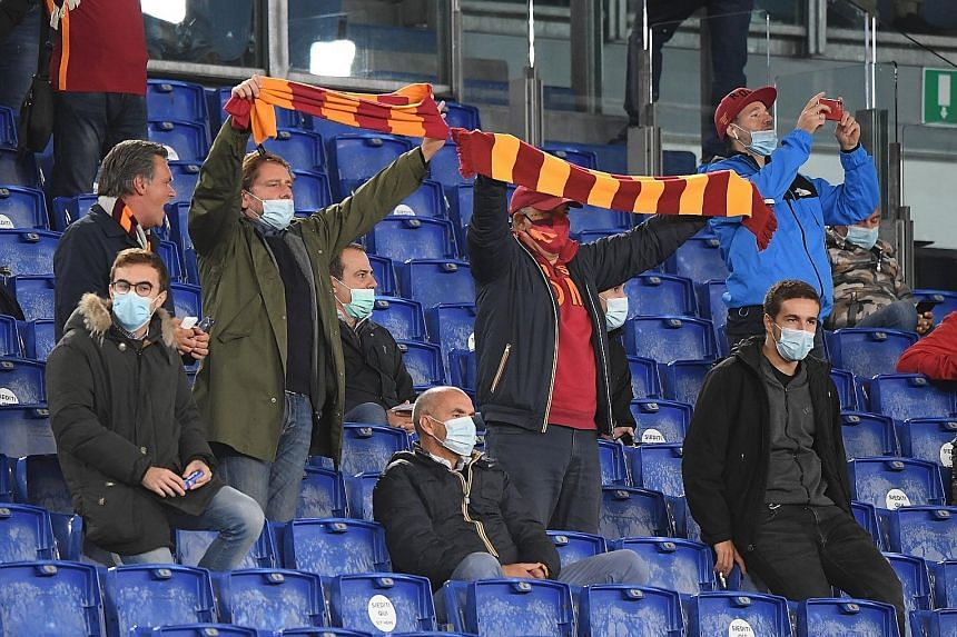 Socially distanced Roma supporters attending their game against Juventus at the Olympic Stadium on Sunday. Serie A teams have been hit hard financially by a shortfall in match-day revenue due to the coronavirus. PHOTO: REUTERS