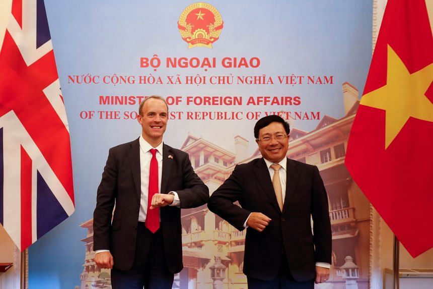 British Foreign Secretary Dominic Raab (left) meets his Vietnamese counterpart Pham Binh Minh at the Government Guesthouse in Hanoi on Sept 30, 2020.