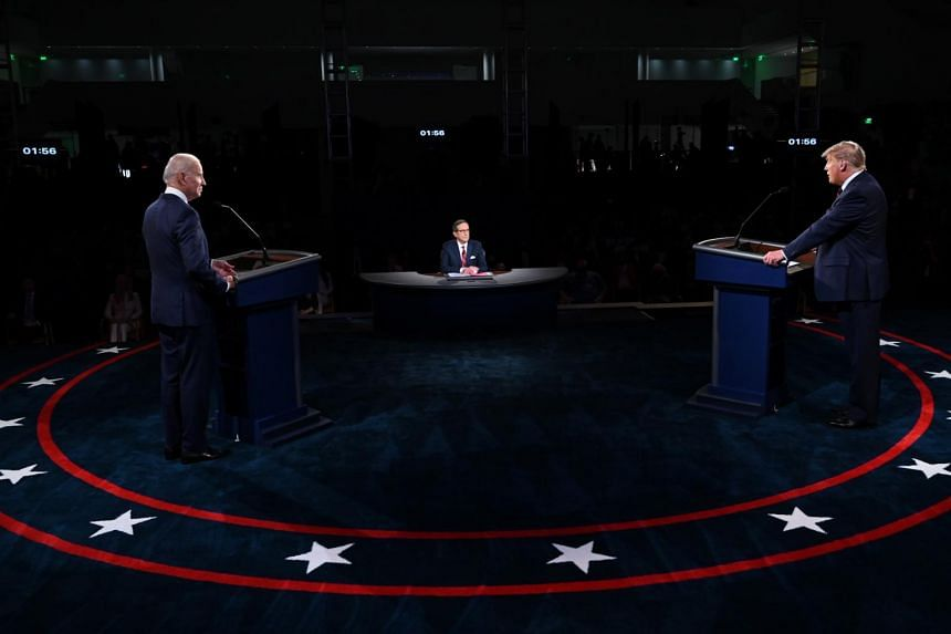 US President Donald Trump and Democratic presidential nominee Joe Biden participate in their first 2020 presidential campaign debate, moderated by Mr Chris Wallace of Fox News Channel, on Sept 29, 2020.