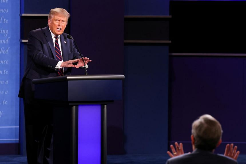 US President Donald Trump argues with debate moderator Chris Wallace of Fox News Channel.