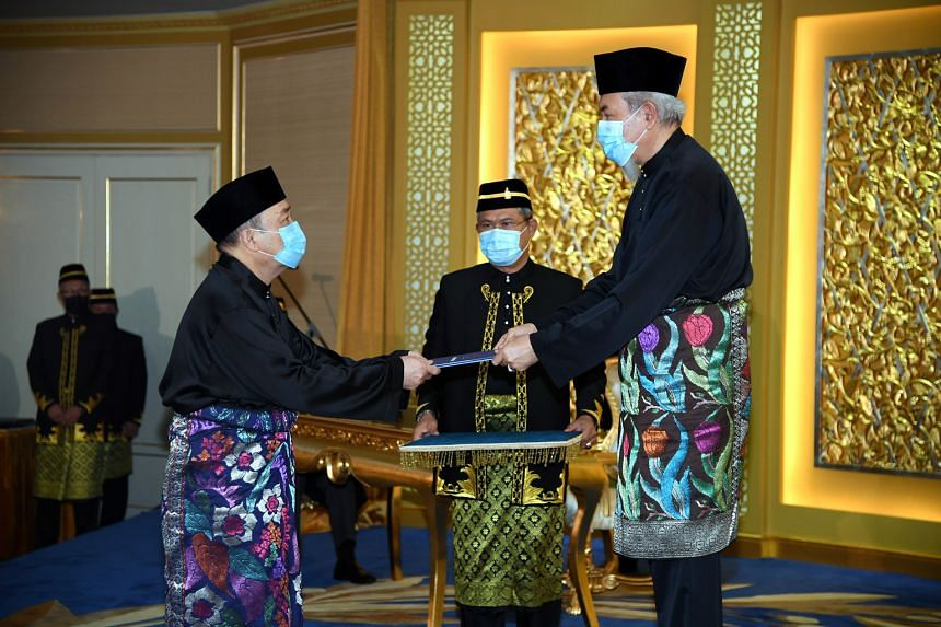 Datuk Seri Hajiji Mohd Noor (left) being sworn in by Sabah Governor Juhar Mahiruddin yesterday. Mr Hajiji's appointment notched up another big win for Malaysian Prime Minister Muhyiddin Yassin, who is facing a leadership challenge in Parliament from
