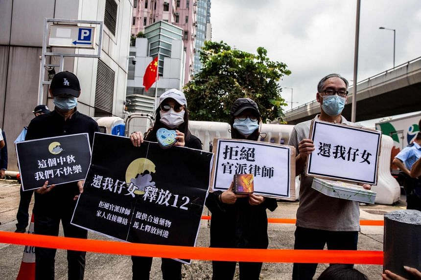 Family members of 12 Hong Kong residents, caught trying to flee the territory, petitioning outside China's Liaison Office on Sept 30, 2020.