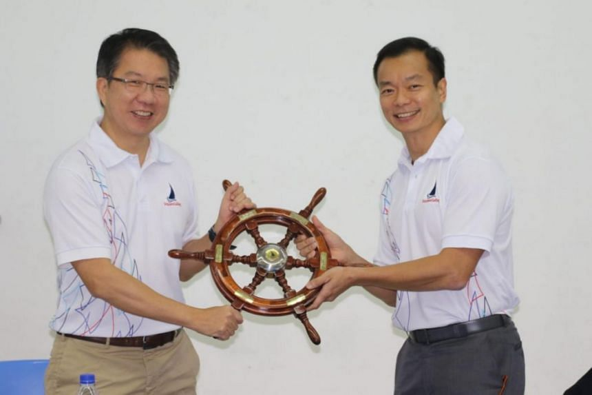 Dr Lincoln Chee (left) pledged to support national sailors bidding to qualify for the Tokyo Olympics.