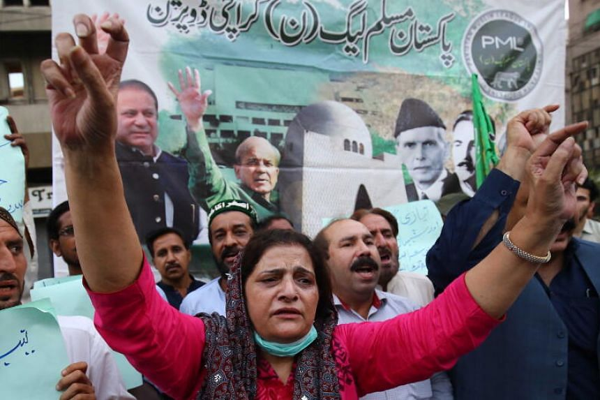 Supporters of opposition party Pakistan Muslim League (Nawaz) (PML- N) shout slogans during a protest after a court rejected bail plea of Shahbaz Sharif in a money laundering and assets beyond income case, in Karachi, Pakistan, 28 September 2020.