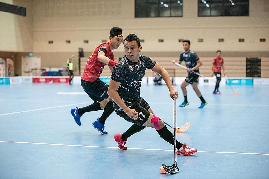 National floorball captain and Black Wondersticks player Syazni Ramlee in action during the final of the ActiveSG-SFA Floorball Premier League play-offs last September at Our Tampines Hub. PHOTO COURTESY OF SINGAPORE FLOORBALL ASSOCIATION