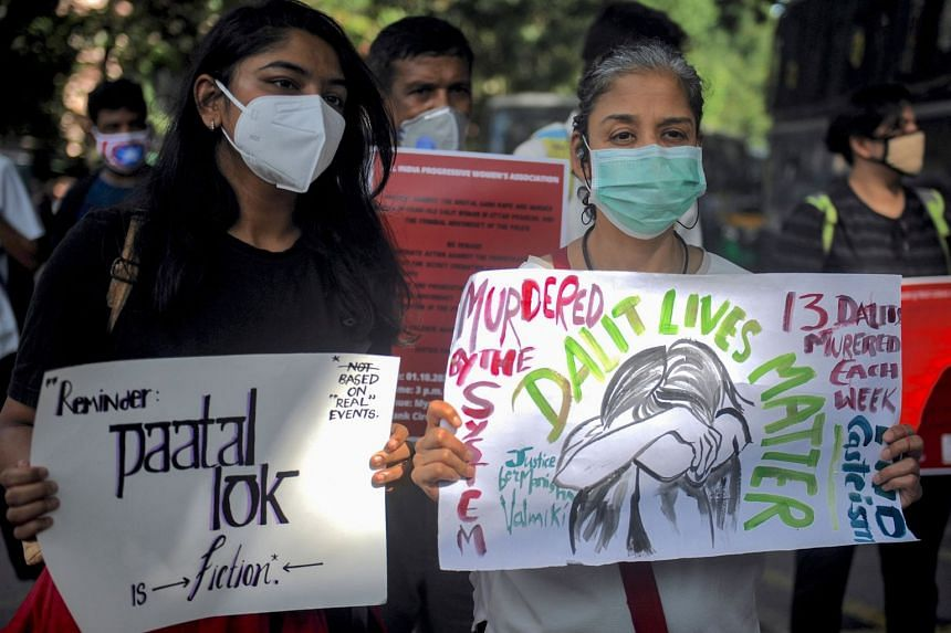 Activists hold placards during a protest over the death of a 19-year-old Dalit woman who was allegedly gang raped by four men last month.