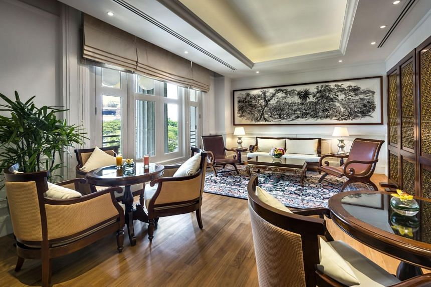 Afternoon tea and evening cocktails are offered at the lounge of The Straits Club at the Fullerton Hotel.