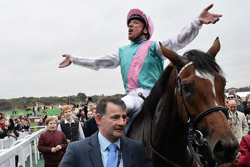 Jockey Frankie Dettori celebrating after Enable's Prix de l'Arc de Triomphe victory in 2018.