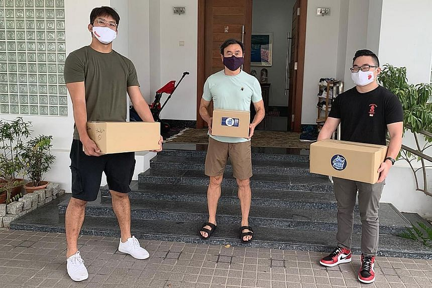 "Basketballer Ng Han Bin (left) and powerlifter Matthias Yap (right) delivering meals to donors at the Chiam See Tong Sports Fund ""Live For Sports"" virtual fundraising dinner."