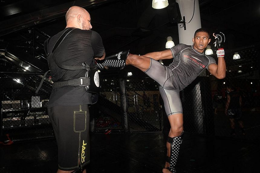 Singapore mixed martial arts fighter Amir Khan has been in training since Phase Two began in June, in preparation for his bout against permanent resident Rahul Raju next Friday.