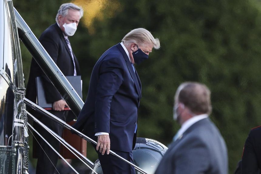 US President Donald Trump arrives at the Walter Reed National Military Medical Center on Oct 2, 2020.