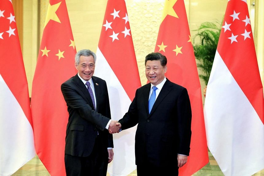 In a photo from April 29, 2019, Prime Minister Lee Hsien Loong meets Chinese President Xi Jinping at the Great Hall of the People in Beijing.