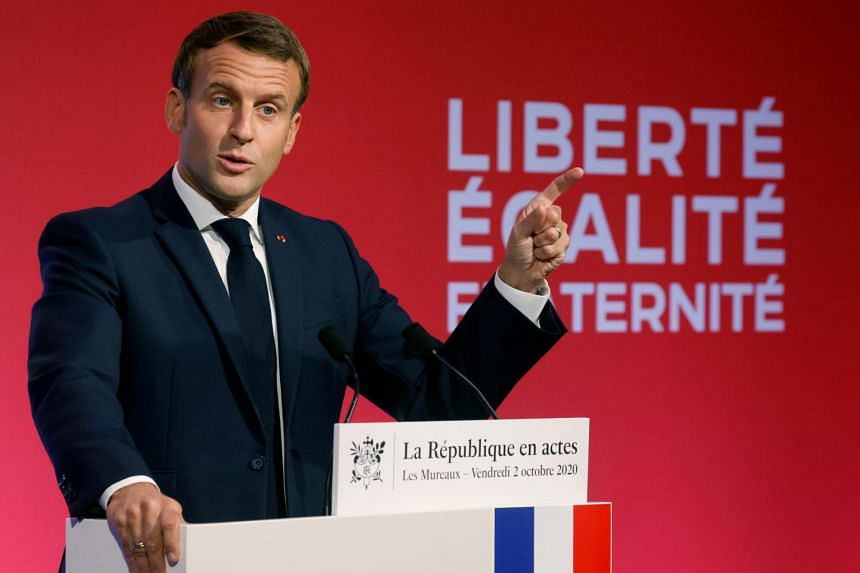 French President Emmanuel Macron presents his strategy to fight separatism, in Les Mureaux, France, on Oct 2, 2020.