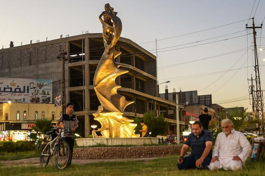 """The statue of """"My Lovely Lady"""" erected in the centre of a square in Mosul, Iraq, on Aug 18, 2020."""