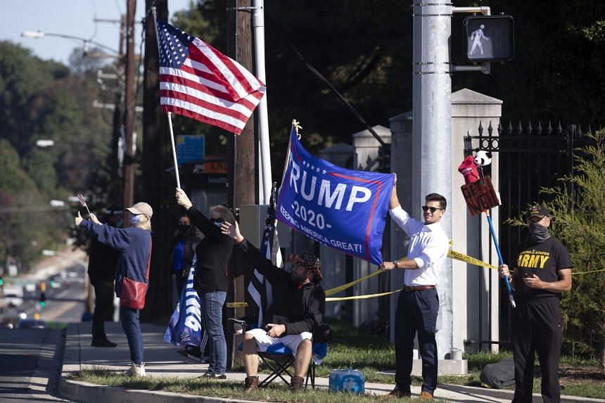 Trump fans show their support outside the Walter Reed National Military Medical Centre.