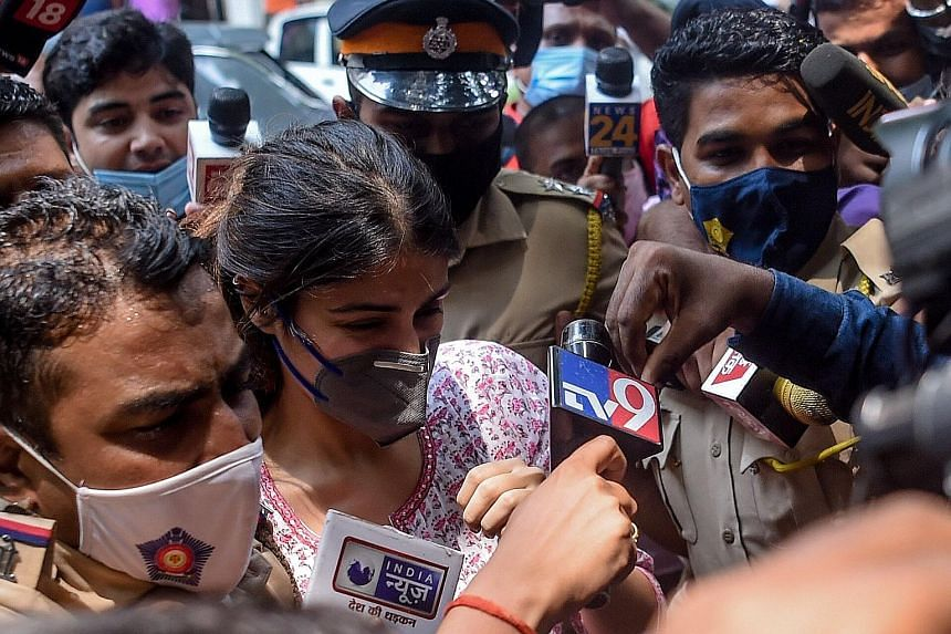 A hoarding in Mumbai last week seeking justice for actor Sushant Singh Rajput. Mr Rajput's actress girlfriend Rhea Chakraborty (above) is among the 20 people arrested in the drug probe launched after his June 14 death. The narcotics agency has summ