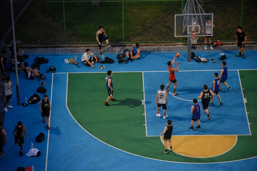 People play basketball next to Blk 351 Hougang Ave 7 on Sept 27, 2020.