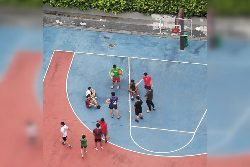 A group playing basketball at the court beside 195B Punggol Road on Sept 27, 2020.