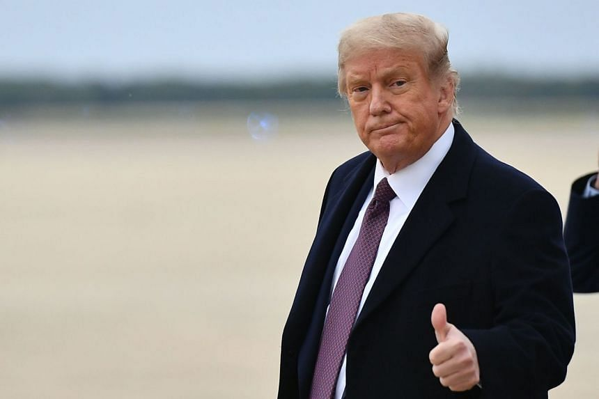 Trump gives a thumbs-up as he steps off Air Force One on Oct 1, 2020.