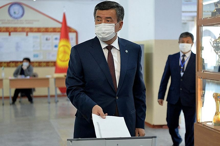 Kyrgyzstan President Sooronbai Jeenbekov casting his vote yesterday in the capital Bishkek. A total of 16 parties are contesting 120 seats in the single-chamber Parliament.