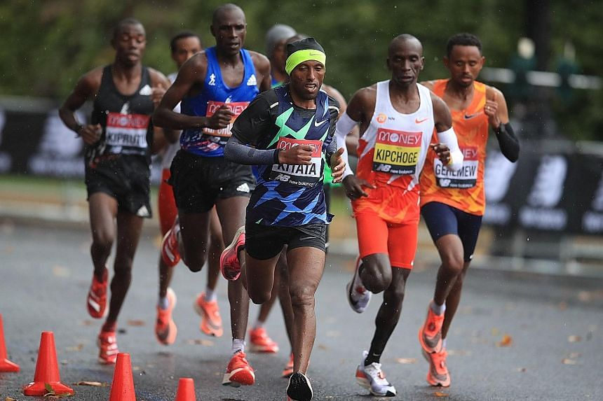 Shura Kitata leading the pack, which included 2016 Rio Games gold medallist Eliud Kipchoge of Kenya, en route to a shock London Marathon win on Sunday. The Ethiopian came home first in 2hr 5min 41sec to go one better than his second-placed finish in