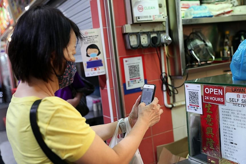 A customer using the SGQR unified e-payment option at a Toa Payoh hawker centre in August. The McKinsey report said the shift towards payment technologies has been fuelled by customer expectations for speed, price differences and higher adoption of a