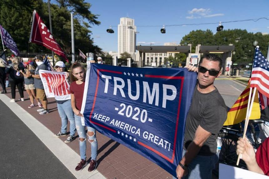 Supporters of US President Donald Trump rally outside Walter Reed National Military Medical Center on Oct 3, 2020.