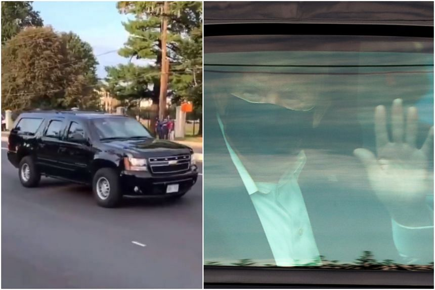 Seen in a dark face mask, waving to crowds, the president's motorcade rolled past before returning to the Walter Reed military hospital near Washington.