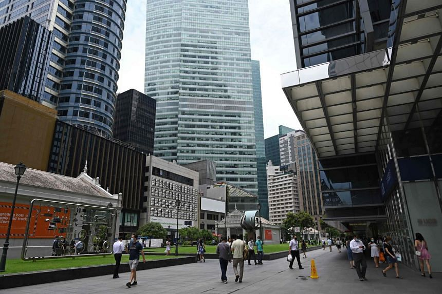 People walk along Raffles Place during lunch break in Singapore on September 15, 2020.