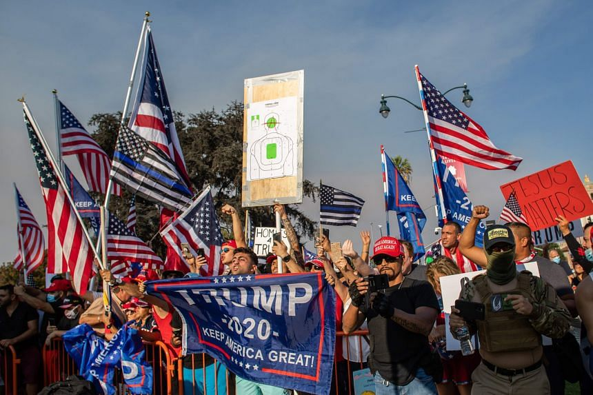"""People at a pro-Trump rally in Beverly Hills, California, last Saturday. To keep supporters energised, the Trump campaign is billing its next phase as """"Operation Maga"""" - a mix of virtual events leading up to Wednesday's scheduled debate between Vice-"""
