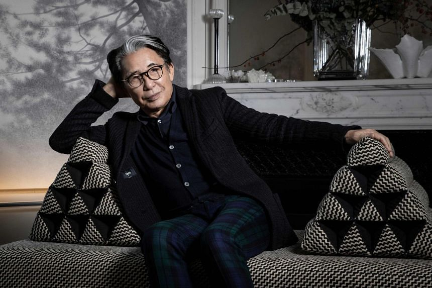 Kenzo Takada, posing for a photo at his home in Paris in January last year, was the first Japanese fashion designer to decamp to Paris and known especially for his signature floral prints.