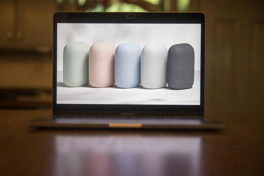 The Nest Audio blends more easily into the background, thanks to its lack of distinctive features.